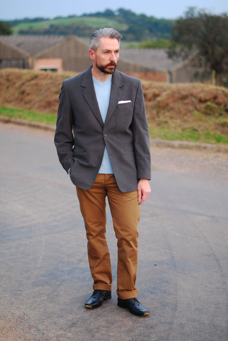 Smart casual menswear: grey blazer, brown chinos, pale blue sweater
