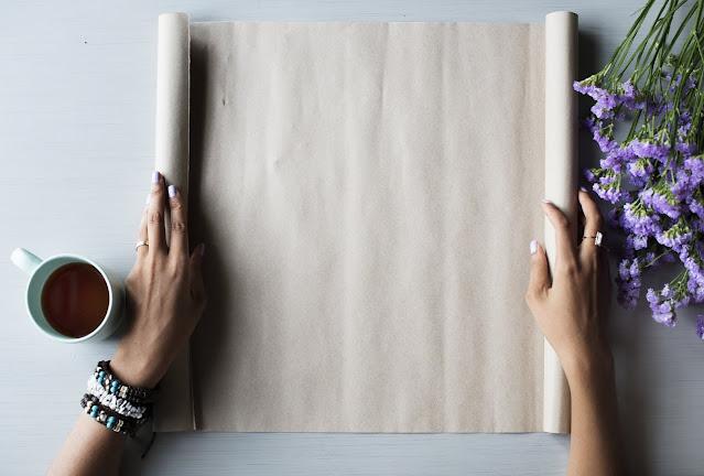 unrolling a clean piece of paper via unsplash.com