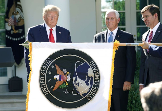 Image Attribute: U.S. President Donald Trump, Vice President Mike Pence and Secretary of Defense Mark Esper look on as the flag of the United States Space Command is unfurled in the Rose Garden of the White House. Dated: August 29, 2019 / Source: Reuters