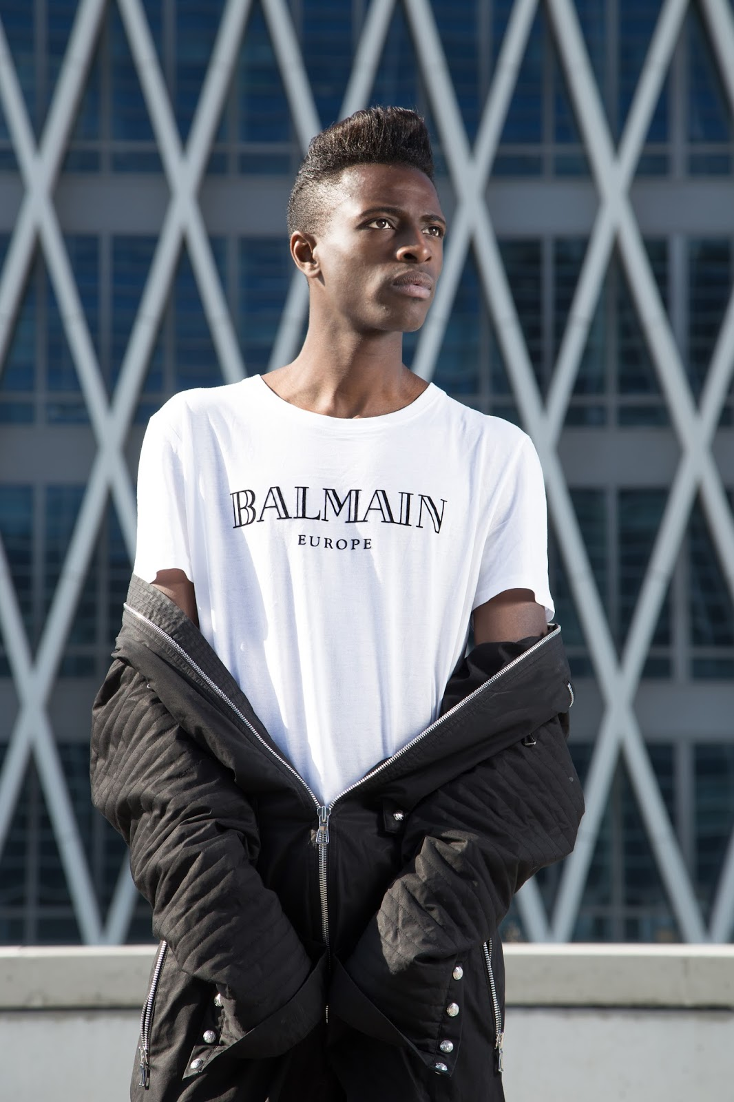 Introducing you Balmain x H&M men's collection + street style guide for Balmain x H&M men's collection written by jonthegold / photography by HOYmedia ( antwerp ) . Wearing balmain europe white tshirt and black jumpsuit menswear