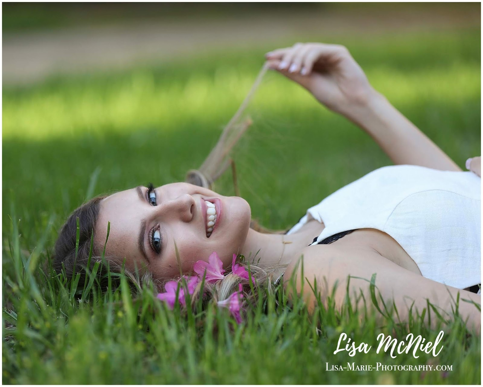 teen girl in flowers and grass
