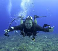 L Scott Harrell is Scuba Diving