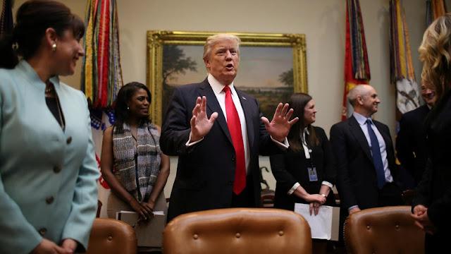 Trump clarifies travel ban policy amid uproar