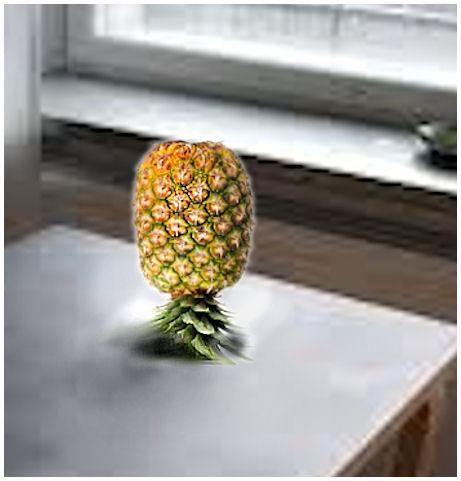 Pöydälle alassuin asetettu ananas.