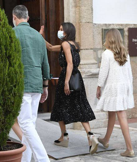 Queen Letizia wore a midi dress by Poete, and espadrille wedges by Macarena. Infanta Sofia wore a textured weave dress by Zara. Princess Leonor