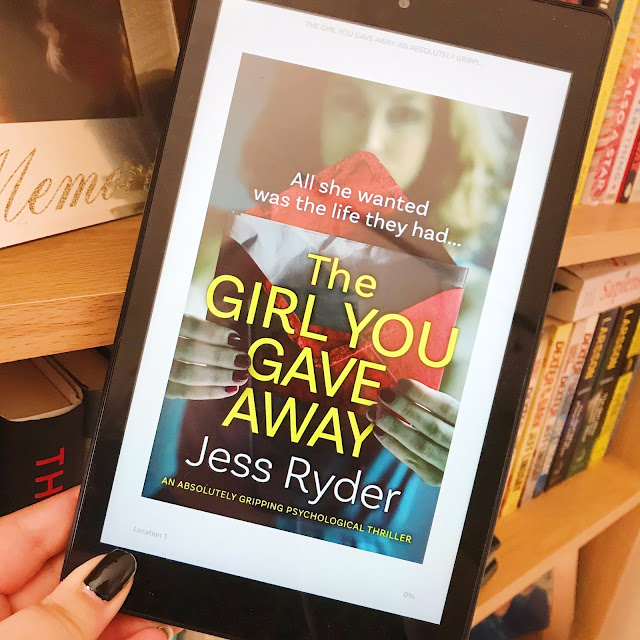 The girl you gave away by jess ryder on kindle held up in front of bookshelf