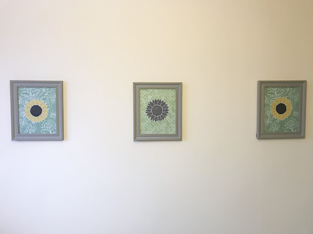 Framed pictures hanging on the wall