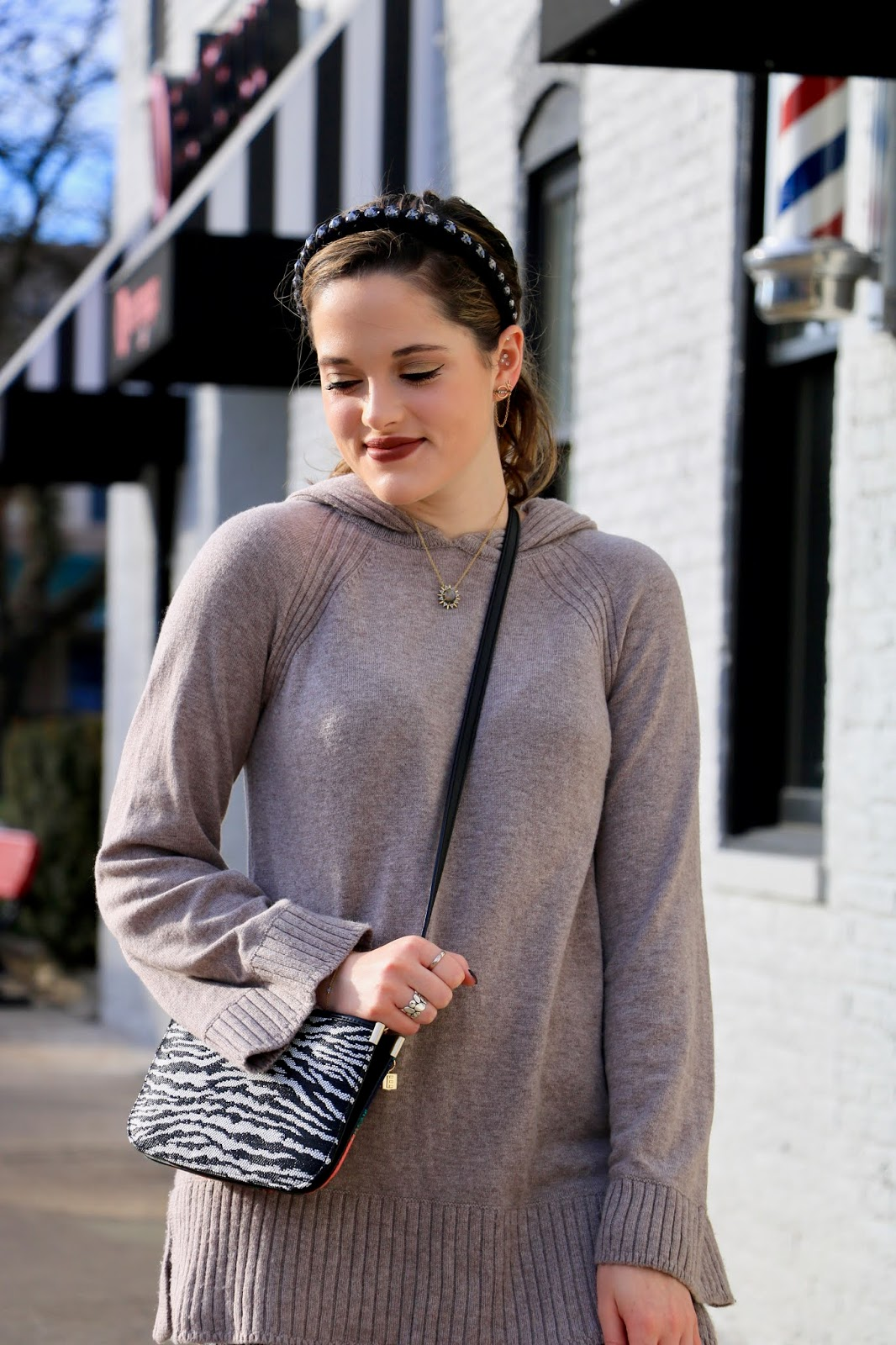 Nyc fashion blogger Kathleen Harper wearing a Zadig and Voltaire zebra purse.