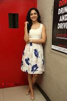 Actress Ritu Varma Stills in White Floral Short Dress at Kesava Movie Success Meet .COM 0088.JPG