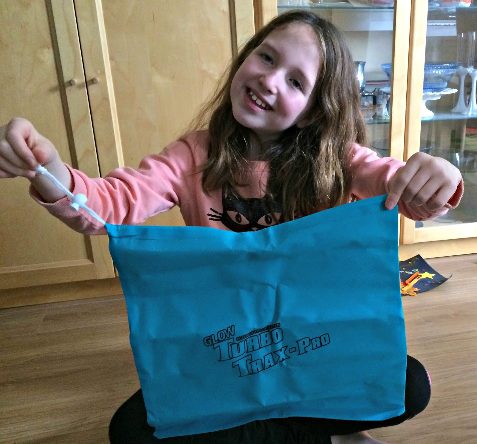 Caitlin holding Turbo Trax-Pro drawstring bag for easy storage