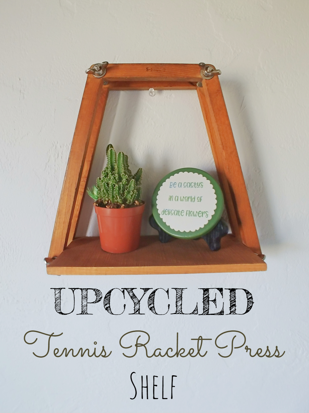 Make a rustic shelf from an old tennis racket press