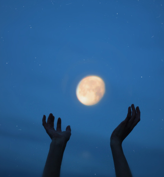 hands raised up to the moon, with Jackson Kiddard quote