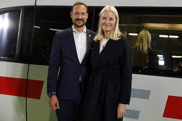 Crown Princess Mette Marit wore Valentino virgin-wool and silk blend midi dress and Valentino stud pumps