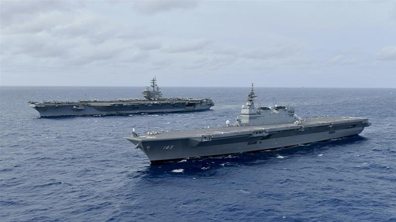 """China calls on US to """"stop flexing muscles"""" in South China Sea"""