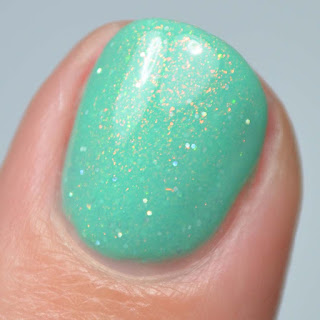 green nail polish with rainbow shimmer