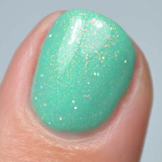 green nail polish with rainbow shimmer