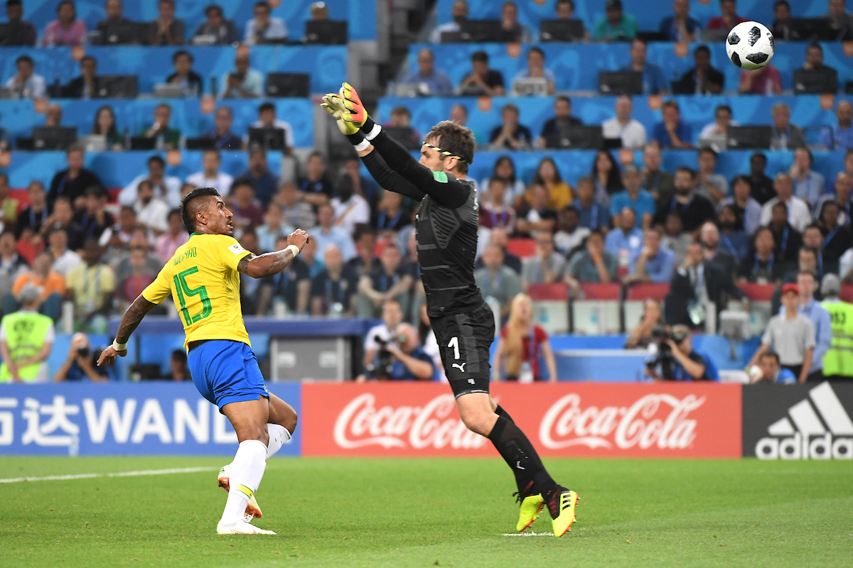 Paulinho of Brazil scores his first side's goal despite of Vladimir Stojkovic of Serbia during the FIFA World Cup Group E match between Serbia and Brazil on June 27, 2018 in Moscow, Russia.
