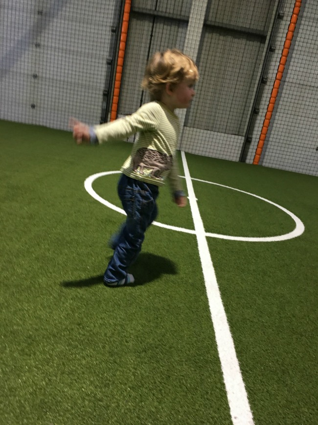 toddler-playing-on-artificial-football-pitch-at-mambo-cardiff
