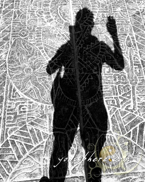 hover_share Shadow of man against tribal designed floor with white sand