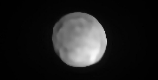A new SPHERE/VLT image of Hygiea, which could be the Solar System's smallest dwarf planet yet. As an object in the main asteroid belt, Hygiea satisfies right away three of the four requirements to be classified as a dwarf planet: it orbits around the Sun, it is not a moon and, unlike a planet, it has not cleared the neighbourhood around its orbit. The final requirement is that it have enough mass that its own gravity pulls it into a roughly spherical shape. This is what VLT observations have now revealed about Hygiea.  Credit: ESO/P. Vernazza et al./MISTRAL algorithm (ONERA/CNRS)
