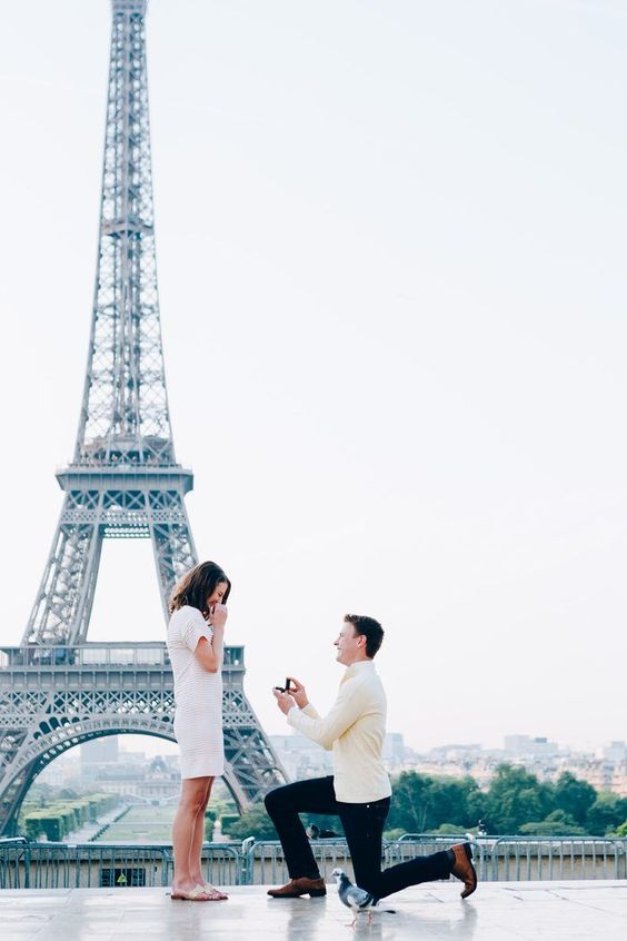 Romantic Ways to Propose in Front of Eifel Tower - The man and the women, both are in white dress