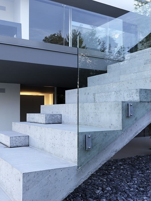 Concrete stairs with glass railing
