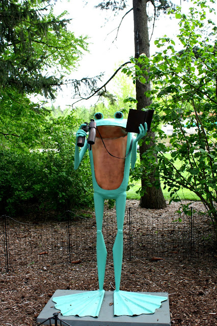 Explorer frog sculpture at The Morton Arboretum