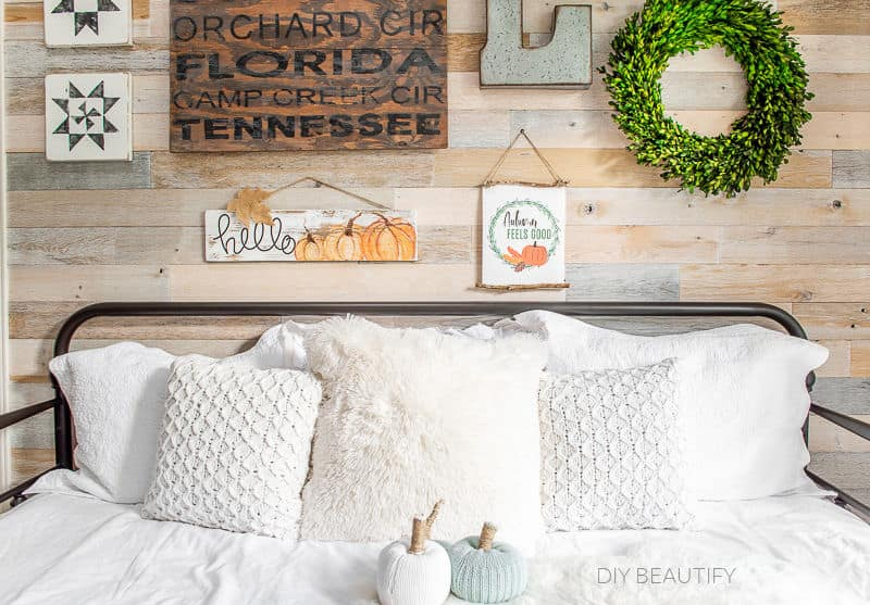 daybed with pillows and fall decor