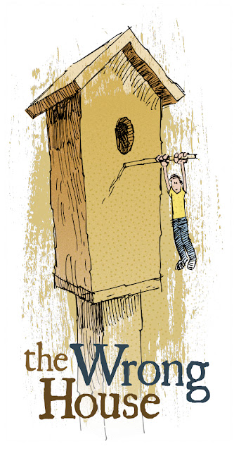 A picture of a guy hanging from a bird house