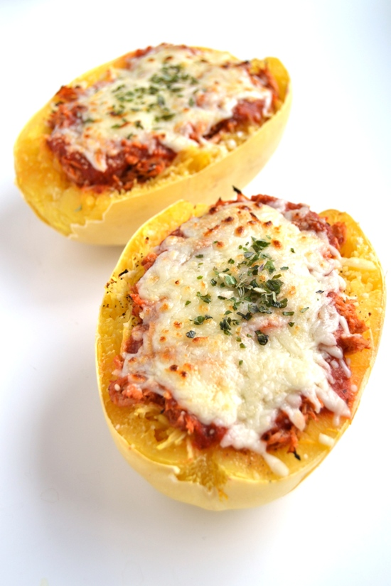 This chicken parmesan stuffed spaghetti squash is a much healthier but still delicious version of your favorite chicken parm. The chicken is cooked in the slow cooker to make it easy! www.nutritionistreviews.com