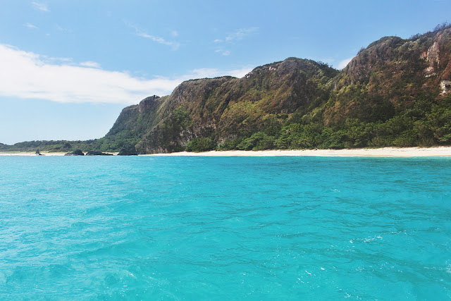 the azure colored waters of Cibang Cove in Calayan Island