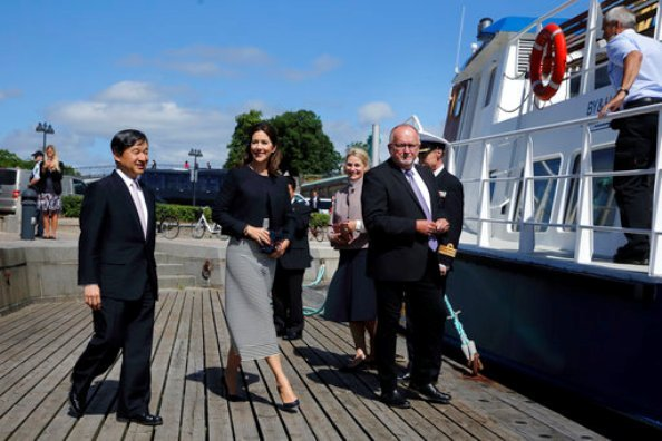 Crown Prince Naruhito of Japan on a boat trip with Crown Princess Mary of Denmark. Princess wore Prada coat and Prada skirt
