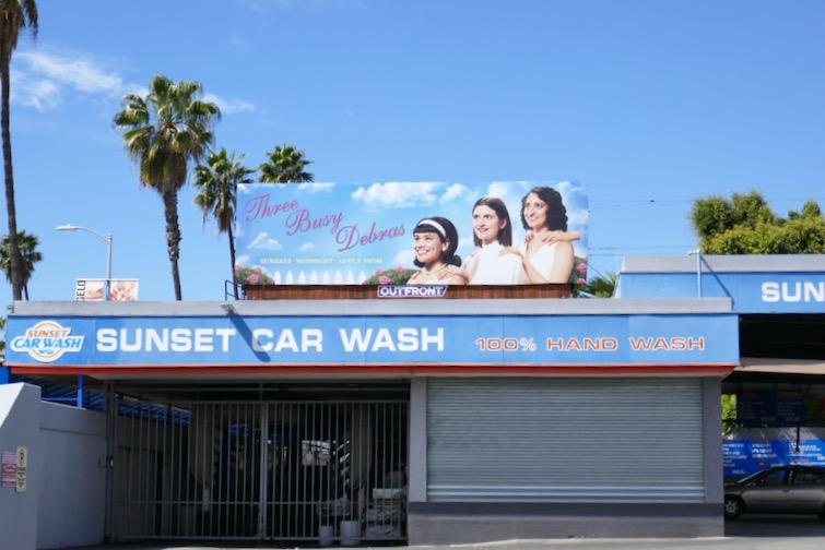 Three Busy Debras TV series billboard