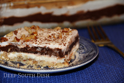 A decadent and well loved dessert made with a shortbread pecan crust and layers of cream cheese, pudding and whipped cream.  Chocolate Sin
