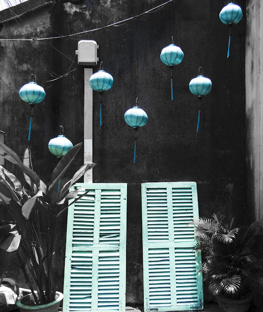Blue lanterns and shutters in Hoi An Vietnam
