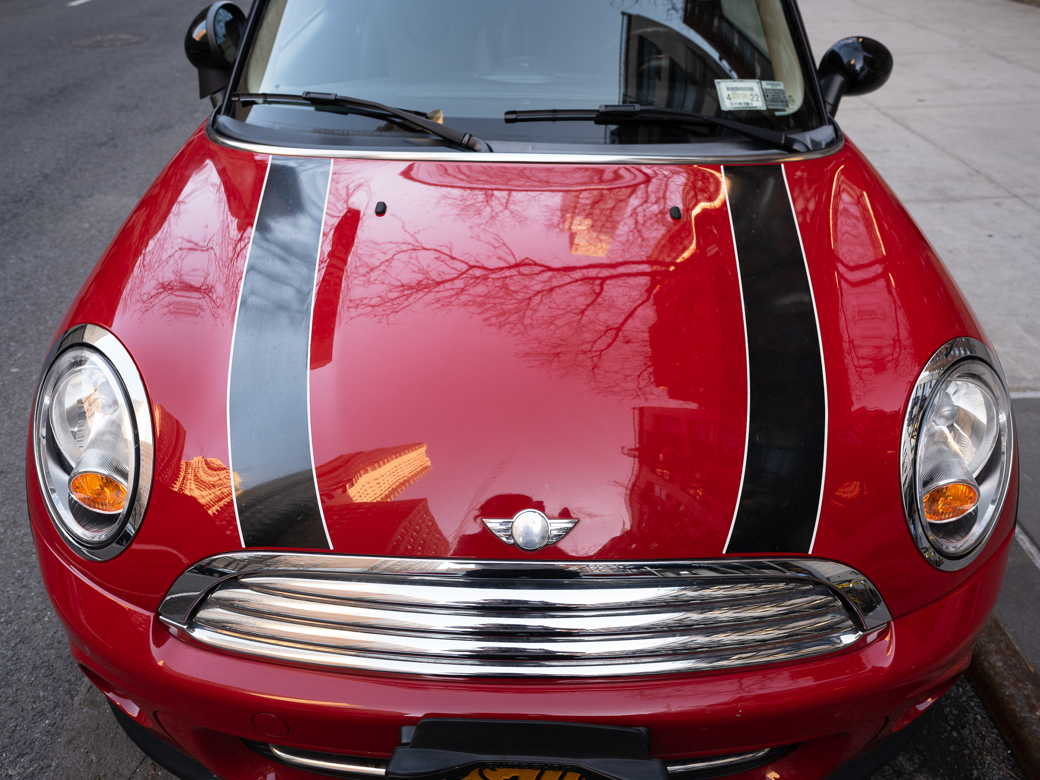 a photo of a red mini cooper parked in new york city