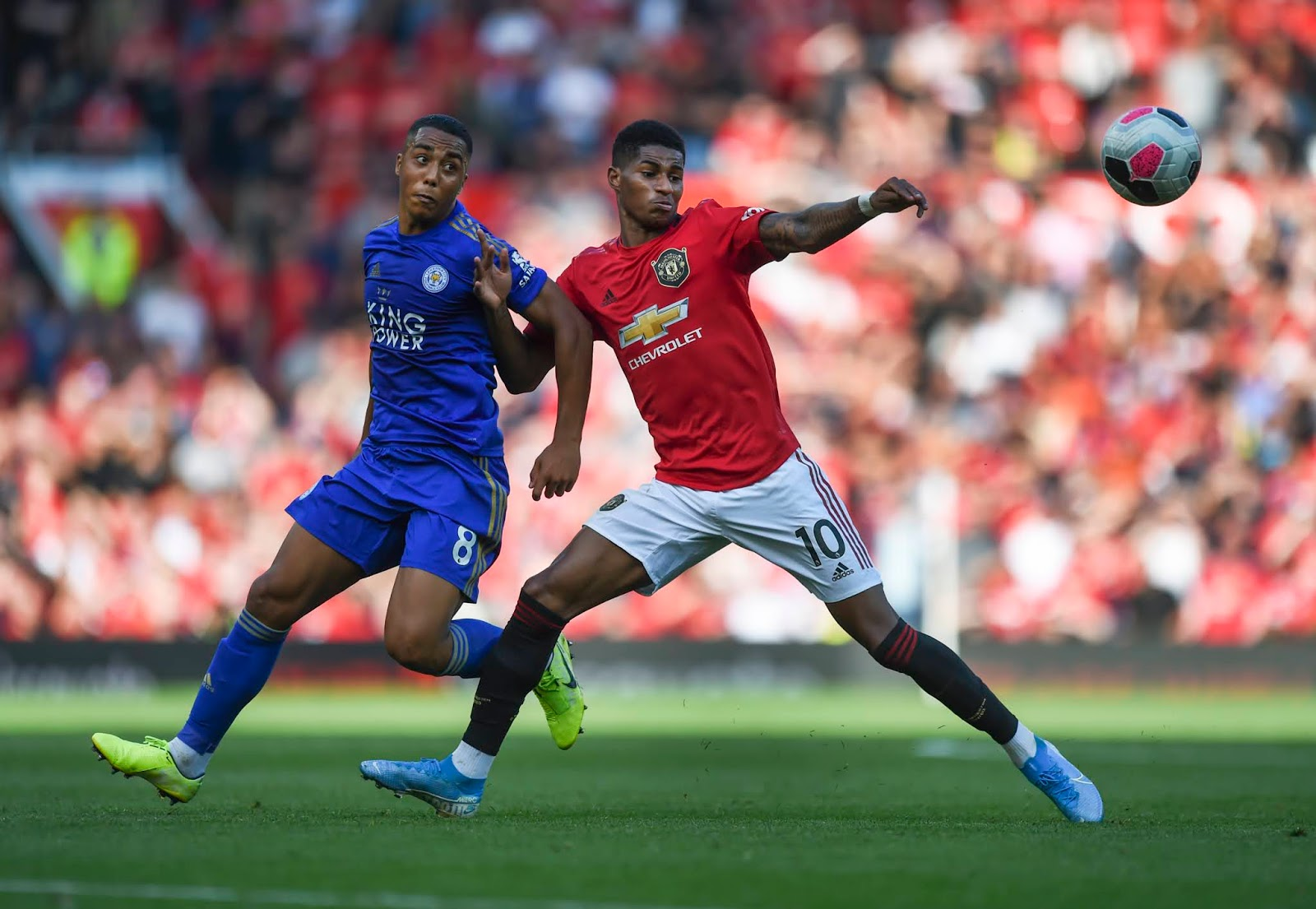 Youri Tielemans and Marcus Rashford duel for possession