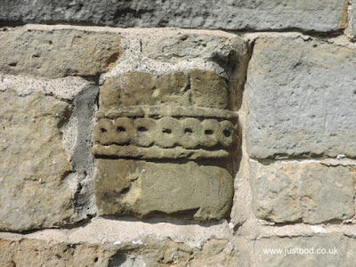 Carved stone fragment in wall of St Hilda's, Ellerburn