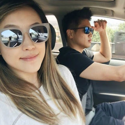 Hayoung Choi talking selfie while her husband driving car