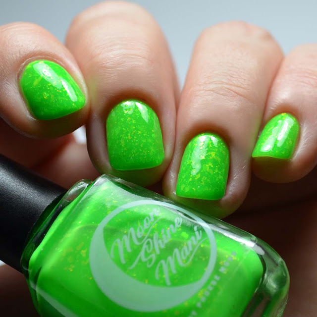 bright green nail polish with color shifting flakies swatch different angle