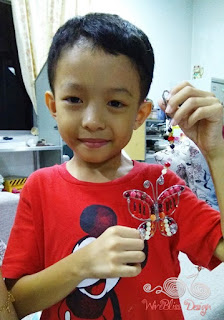 Happy boy with wire wrapped butterfly by WireBliss