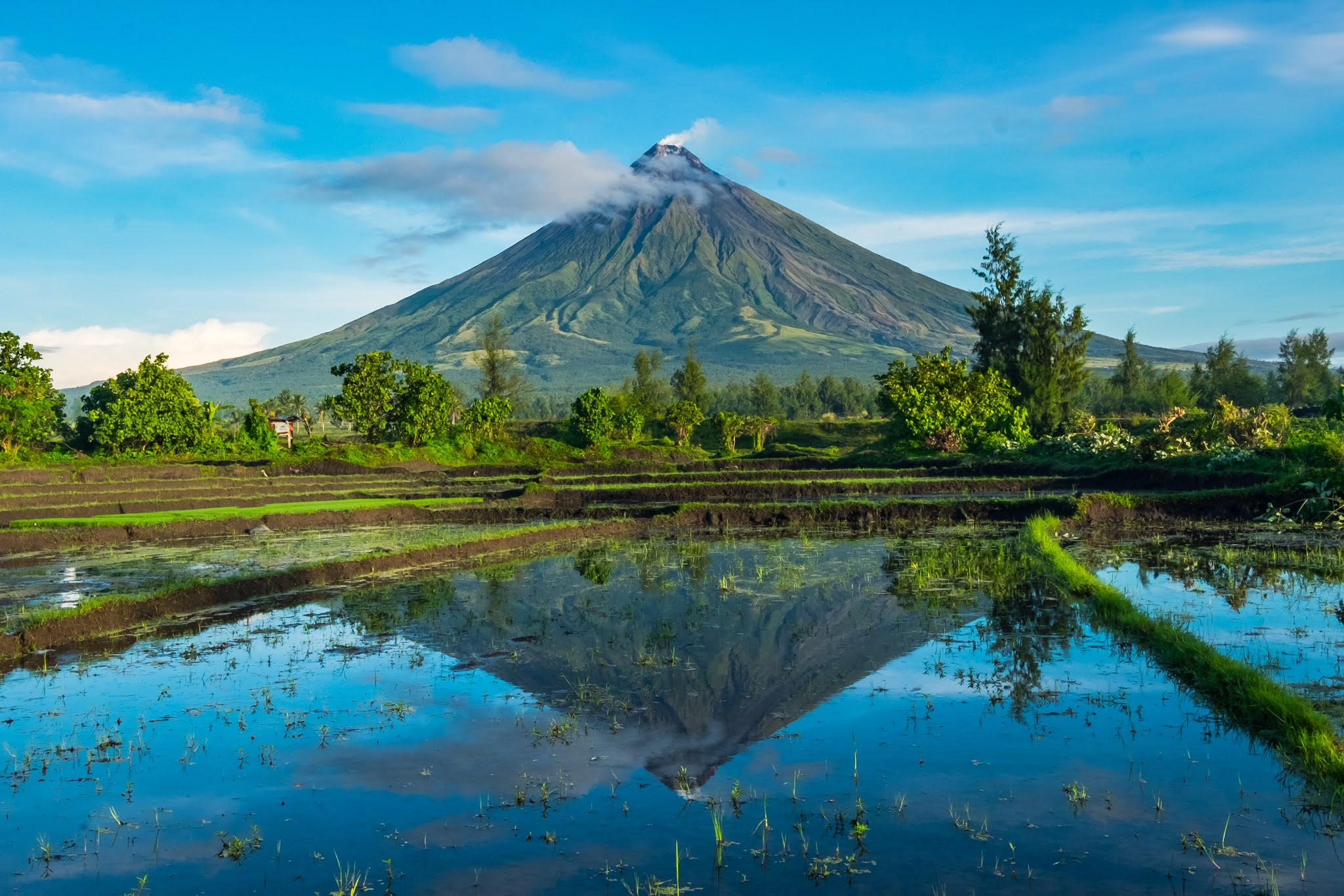 The reflection of Mayon Volcano in the water