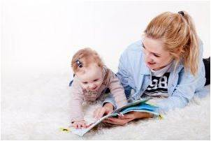 Mother reading to her baby to illustrate one of the things to do with kids during corona virus quarantine