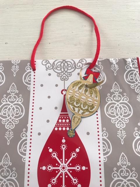 gold Christmas gift tag hanging Christmas gift bag red ornament
