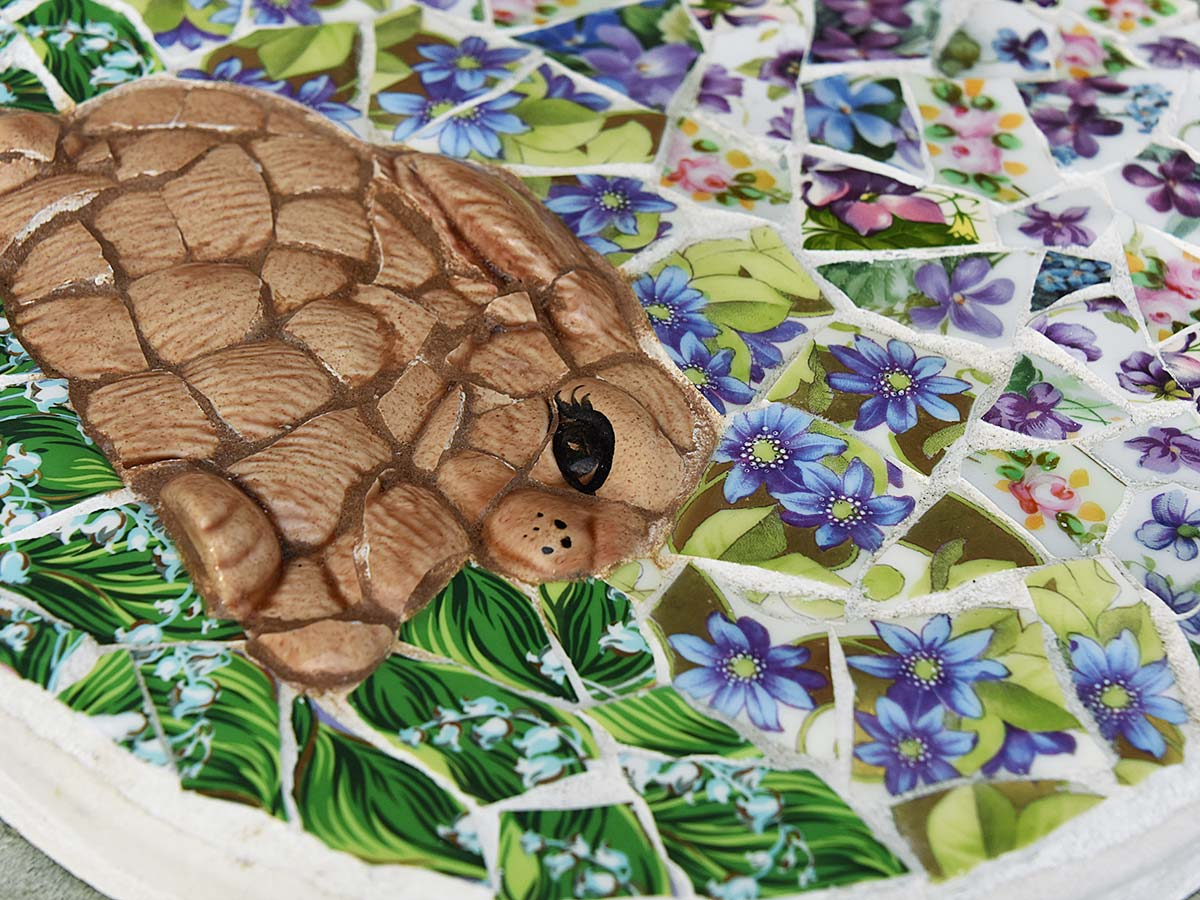 Mosaic bunny dreaming of flowers stepping stone