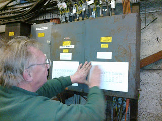 John documenting circuits on the distribution boards
