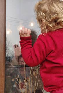 Waving to mummy through the window