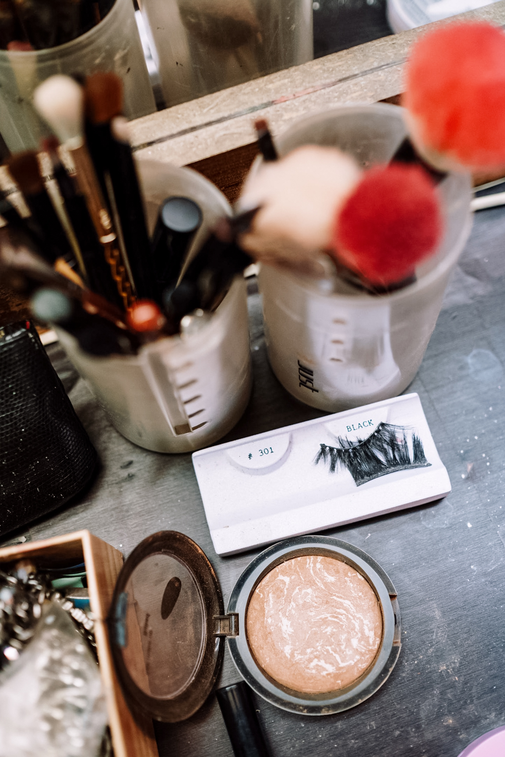 a bucnh of makeup products on the table