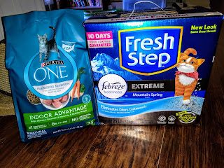 Free box of cat litter and bag of dry cat food