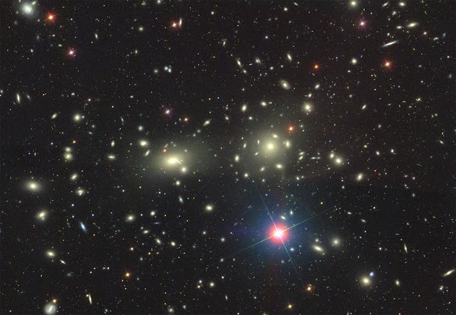 A young mammoth cluster of galaxies sighted in the early universe
